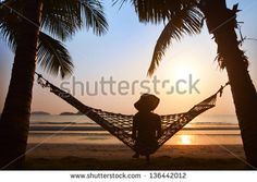 Silhouette of Woman Alone On Beach at Sunset