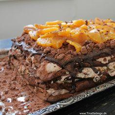 Verdens bedste kage – her med rutebiler og appelsiner Sidste lørdag holdt vi velkomstfest for sønnike, der kom hjem efter et halvt år i Australien. Det skulle jo fejres med manér og derforfa…