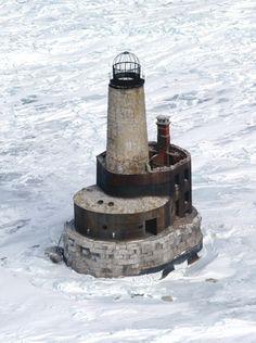 Waugoshance Lighthouse. Located roughly two miles northwest of Waughoshance Island, the western most island of Wilderness State Park. Latitude: 45.78617 Longitude: -85.091