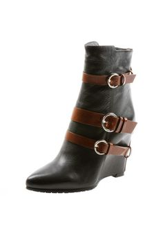 I love this Contrast Buckle Ankle Boot https://www.shoptiques.com/products/contrast-buckle-ankle-boot @Shoptiques
