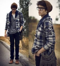Black pants a hat and a flannel jacket