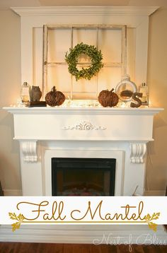 Fall Fireplace Mantel.  acorns in lanterns.  tiny white lights, boxwood wreath, owl, twig pumpkins....