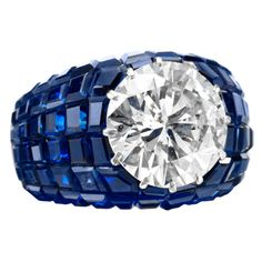 Important 'Mystery Set' Sapphire and Diamond Ring : Van Cleef & Arpels Invisibly set circular-cut diamond (5.22 carat) set with 19 carats of invisibly set sapphires in white gold. France c1951
