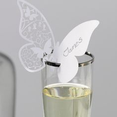Elegant white butterfly place cards.