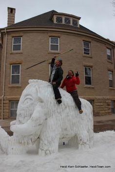 Team #Breck riding their 3rd place mammoth at #Loveland, #Colorado's #Snow Sculpture #festival. Photo by HeidiTown.com. Read more: http://thearmoryworkspace.com/blog/lovelands-snow-sculpture-dark-2013-winning-sculptures#