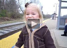 This three-year-old waiting for a train is the face of sheer delight (Video)