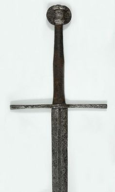 Hand-and-a-half Sword • Dated: circa 1300 - 1350 • Culture: Western European, almost certainly German • Place of Origin: Germany (production) • Medium: steel • Measurements: overall length, 118 cm....