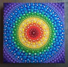 Rainbow Chakra inspired mandala painting. Dot Art. Dot painting.