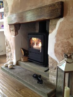Dunsley Highlander 7 solo, medium character oak fireplace beam, stepped reclaimed Yorkshire stone hearth and patch plastered walls and rendered recess. Oak Fireplace, House, Front Room, Home, Wood Burner, Fireplace, Brick Fireplace, Fireplace Beam, Inglenook Fireplace