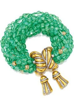 Verdura Double Tassel Bracelet 18k gold, diamond and platinum tassel clasp with 16 strands of oval emerald beads interspersed with ten diamond-set gold rondels.