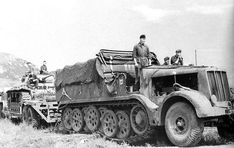 A Famo SdKfz 9 18-ton halftrack is transporting a Panzer 3 on it's special purpose Sd.Ad. 116 trailer.