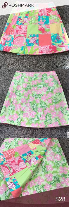 Lilly Pulitzer reversible tiger cloud print skirt I think this skirt is a size 0 since it is reversible there are no tags flat waist measurement is 12.5 inches the skirt has two small buttons 15 inches from top to bottom Lilly Pulitzer Skirts Mini