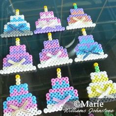 Perler hama fused bead little birthday cakes with bows.