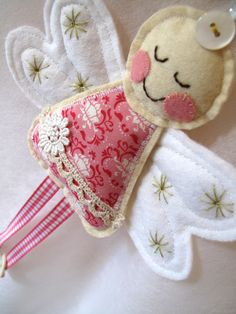 Pretty pink angel What a cute idea for Christmas ornaments...or present topper