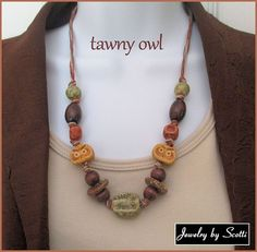 """Knotted Hemp Owl Necklace. A gorgeous set of woodsy ocher, olive green, and brown glazed stoneware and ceramic beads made by Mari Carmen Rodriguez Martinez form the central theme of this """"Tawny Owl"""" n"""