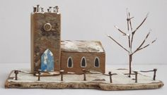 Miniature church in snow by Kirsty Elson