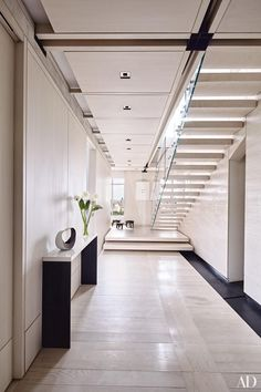 A New York City triplex gets a savvy revamp complete with a spacious living area that doubles as a recital hall
