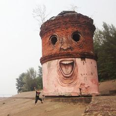 The Living Wall: street artist Nikita Nomerz turns derelict buildings into   faces.