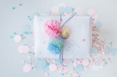 Inspiration: gift wrap with honeycomb paper pom pom and thread pompom from StyleStek.