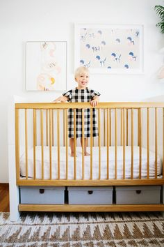 Two-year-old Tola dons a gingham dress in her David Netto crib.