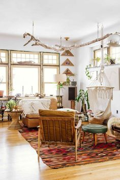 bohemian living room with wooden natural accents, indoor plants, window space, and natural textures
