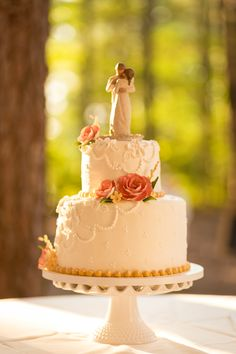 Wedding cake by Baker's Kitchen, with the Willow Tree cake topper