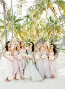 Love the different color dresses, including the brides.  Perfect for a beach wedding.