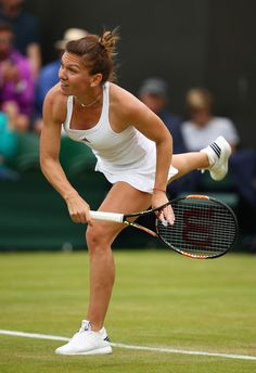 Simona Halep Photos - Simona Halep of Romania serves during the Ladies Singles second round match against Francesca Schiavone of Italy on day four of the Wimbledon Lawn Tennis Championships at the All England Lawn Tennis and Croquet Club on June 30, 2016 in London, England. - Day Four: The Championships - Wimbledon 2016
