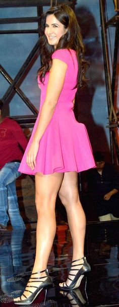 Katrina Kaif sizzled in a hot pink flair number paired with strappy sandals at the launch of the the title track of the film, 'Dhoom:3'. #Bollywood #Fashion #Style #Beauty