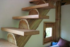 Scroll down to see the staircase stringer carved from a tree trunk!
