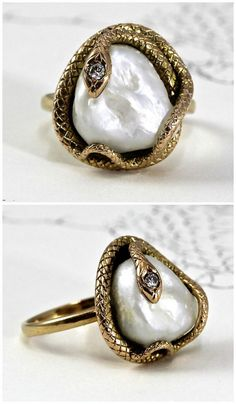 Antique snake ring in yellow gold with a large baroque pearl. Art Nouveau; at The Eden Collective.