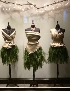Window display at hotel boutique in Grand Rapids, Mi. Mannequins with dresses made from burlap and evergreens. So cool!
