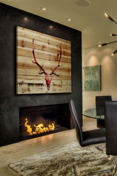 When you like the idea of barnwood on your #fireplace, but don't want to commit -- do it with art.