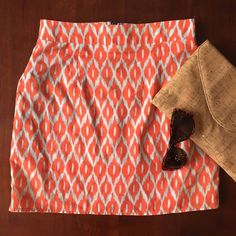 Ikat patterned skirt with colored exposed zipper Adorable fitted mini skirt in a coral and grey/cream ikat pattern. Has pockets on either side and a fitted waistband. Fabulous detail in the back with an exposed zipper in cobalt blue. Comfortable and lightweight, 100% polyester. Francesca's Collections Skirts Mini