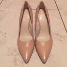 Nine West Brand New Pumps Nude pumps worn once. Fit me tight in the front. They are a size 8 but I have a wide foot so unless you're a narrow 8, I recommend for a 7 1/2. Excellent condition. Nine West Shoes Heels