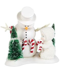 A sweet treat. Snowbaby and snowman decorate the forest with festive candy canes in this cute collectible from Department 56. | Porcelain bisque/polyresin/nylon | Use a soft feather duster | Imported