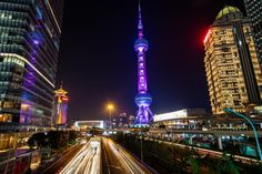 The Shanghai Pearl tower in purple, amongst the other skyscrapers in this amazing Chinese city.