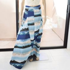 """NWT Show Me Your Mumu Princess Di Maxi Skirt Gorgeous beachy print Show Me You Mumu Princess Di maxi skirt. High waisted & zips up on the side making your waist look tiny. Sweeps out long & full, like a ballgown. Perfect for any occasions! Easy to dress up or dress down! Brand new! Size small. 100% poly. * 2 available* Length: 43"""", Waist: 26.5"""" -- Mannequin: 5'7"""", Waist: 24"""", Hips: 34.5"""". Offers Welcome! Proceeds go towards helping animals! Show Me Your MuMu Skirts Maxi"""