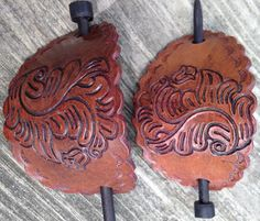 This barrette is handtooled latigo leather and uses a wooden dowel to fasten in place. Fair trade. Handcrafted in Peru.