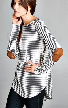 - Semi-loose fit, long sleeve, round neck, hi-low top. Rounded hems. Has faux suede elbow patch on sleeves. This top is made with heavy weight striped knit fabric that is soft, drapes well and has gre
