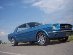 1964 Ford Mustang Standard Coupe.  I was born on the same day the first Mustang rolled off the assembly line.  I think Ford should give me one.  If I win the lottery this is the first thing I'm buying!