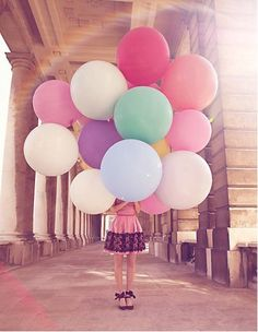 Birthday picture idea: Each year, for your child's birthday, you could have them hold the same number of balloons as their age.