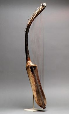 Ancient Egyptian arched harp (shoulder harp) frem c. BCE, in the Metropolitan Museum of Art / musical instruments