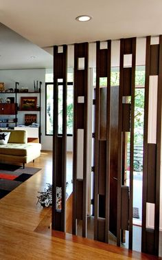 Want to divide the living room into several parts? The most perfect solution is to use the living room partition. By using partitions, you can partition the room but not permanently because it can … Home, Living Room Partition, House Design, Wooden Partitions, Living Room Designs, Room Partition Designs, Interior Design, House Interior, Divider Design