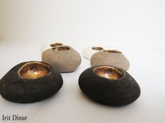 Shabbat candlestick, Ceramic Candle holders, Holiday decor, Shabbat shalom, judaica, Trendy pair of Shabbat candlesticks, Made in Israel  A Stylish and unique set of round ceramic candle holders. look fantastic as a focal piece on your Shabbat table. This one of a kind candlestick is made from gray clay and glazed in beautiful pure gold.  Each candle holder measures approx 2 (5 cm) diameter by 1.5 (3 cm) tall.  Shipping: ● Ships within 3-5 work days ● Securely packaged for shipping, comes in…