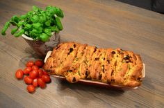 Pull apart bread with parmesan, tomato and basil