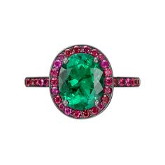 Manuel Bouvier Emerald Ring with Ruby Surround Oval-shaped emerald ring, with a pavé ruby surround and partway pavé ruby shank, the emerald weighing 2.00 carats (Gubelin-certified: minor oil enhancement, Colombian origin) and 48 rubies weighing 0.52 total carats, mounted in blackened 18k white gold. Designed by Manuel Bouvier. Comes with certificate for the emerald from the Gubelin Gem Lab. Re-sizable. Available at Betteridge