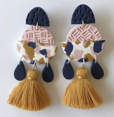 mustard & pink tassel earrings  #handcrafted #handmade #giftideas # handcraftedgifts #artistmarket #creativefinds #onlinegiftstore #uniquegifts #handmademovement #supportsmallbusiness #madewithlove #giftsforher #earrings