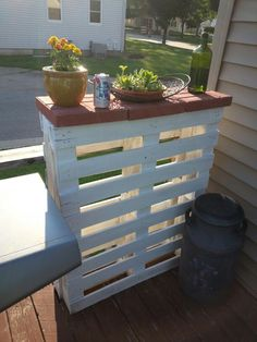 """Pallet Bar Table...screwed 2 same size pallets together, painted white, and put 3 12""""x12"""" red pavers on top."""