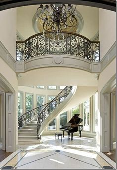 Almost exactly how I want my wedding to take place at. Staircases and high ceilings  love the grand piano!!!